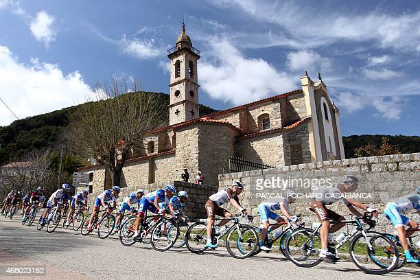 Cyclists compete in the third stage of the 84th Criterium International Cycling race on March 29 in Levie on the French Mediterranean island of...