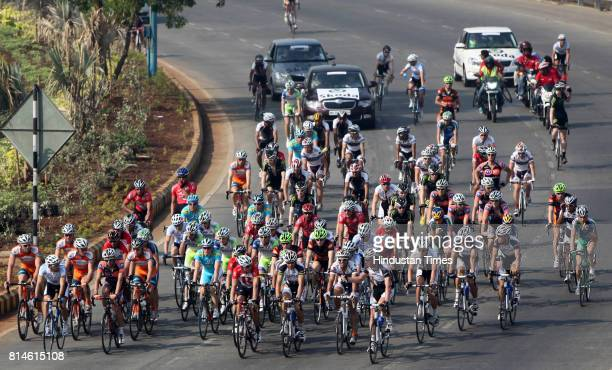 Cyclists compete in the Tour de Mumbai cycle race at Bandra in Mumbai on February