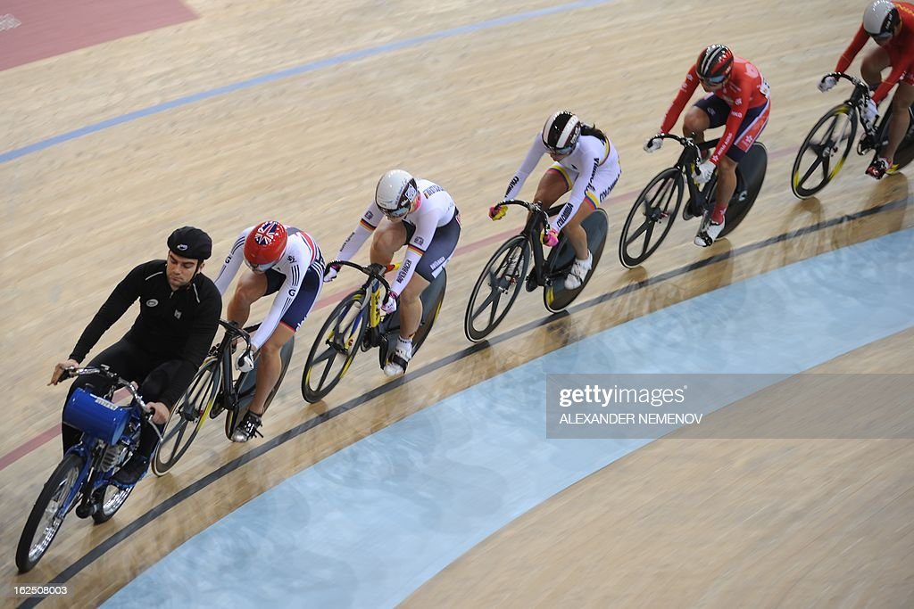 Cyclists compete in the women's keirin event of the UCI Track Cycling World Championships in Minsk on February 24, 2013. AFP PHOTO / ALEXANDER NEMENOV