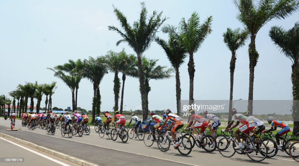 Cyclists compete on January 20 2013 during the seventh and last 126 kms stage of the eighth edition of the Tropicale Amissa Bongo cycling race...