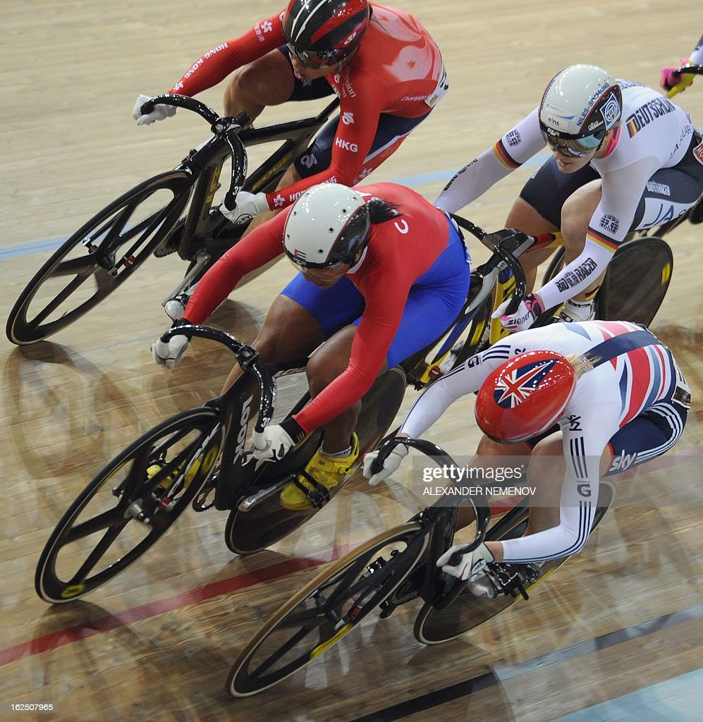 Cyclists competes in the women's keirin event of the UCI Track Cycling World Championships in Minsk on February 24, 2013.