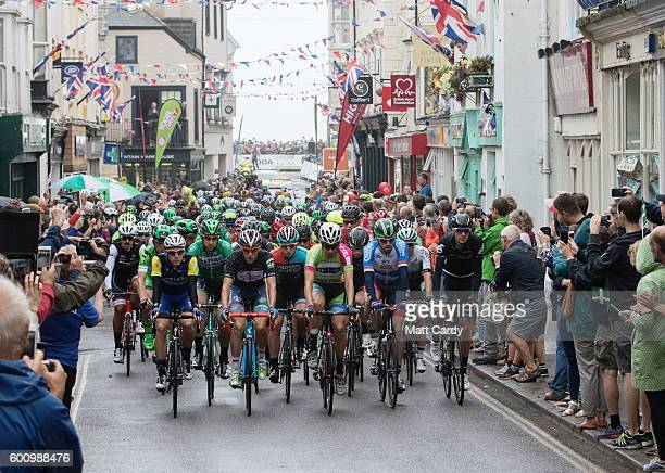Cyclists competing in the Tour of Britain cycle up High Street at the race start in Sidmouth on September 9 2016 in Devon England The eight stage...