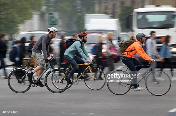 Cyclists cross a road junction near Vauxhall Bridge on April 29 2014 in London England Union members are striking for 48 hours in a dispute over...