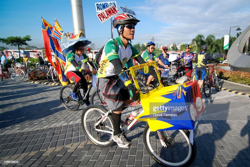 Cyclists decked in colorful attire ride in the streets during the annual Tour of the Fireflies cycling event on November 18, 2012 in Manila, Philippines. The annual event organized by the Firefly Brigade, a cycling group of environmentalists, aims to promote cycling as a sustainable form of transportation in Metro Manila and has become a rite of passage for a growing number of weekend cyclists from all walks of life.