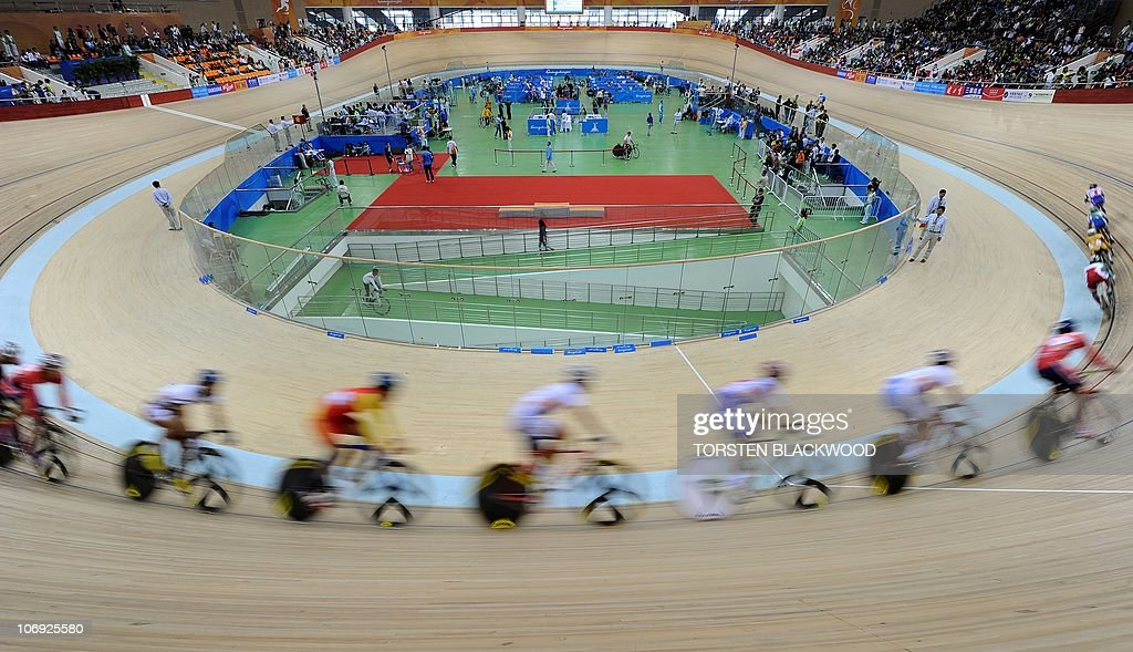 Cyclists follow in each others' slipstream during the men's points race cycling final at the 16th Asian Games in Guangzhou on November 17, 2010. The race was won by Vladimir Tuychiev of Uzbekistan. AFP PHOTO / Torsten BLACKWOOD