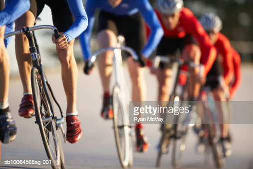 Cyclists in action, low section (focus on foreground) : Stock Photo