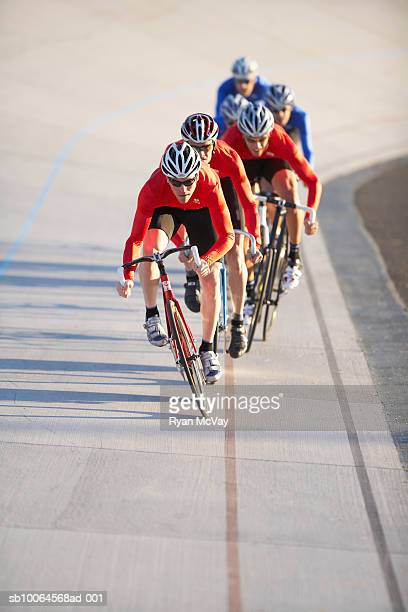 Cyclists in action on velodrome track