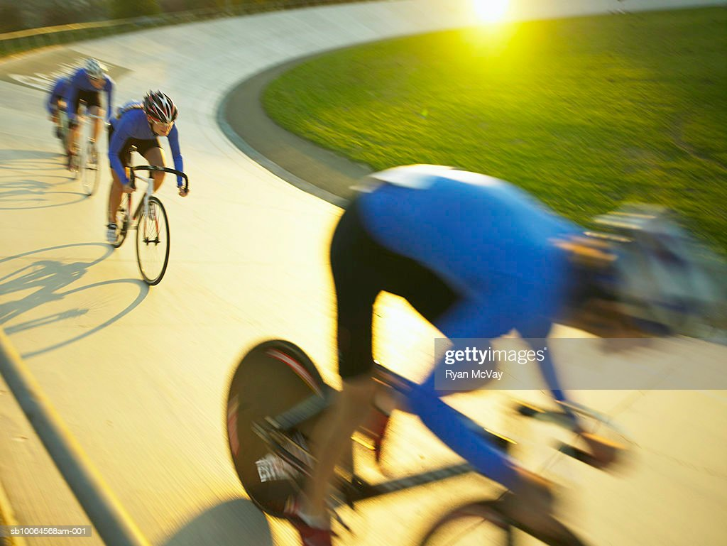 Cyclists in action on velodrome track (blurred motion)