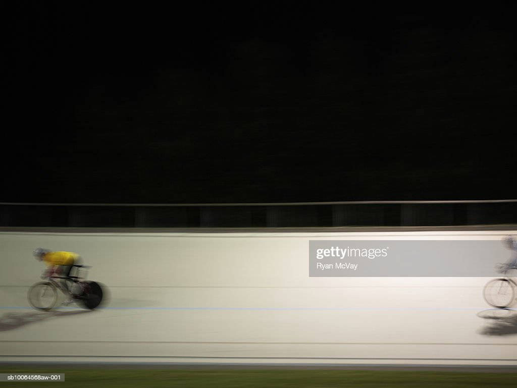 Cyclists in action on velodrome track : Stock Photo