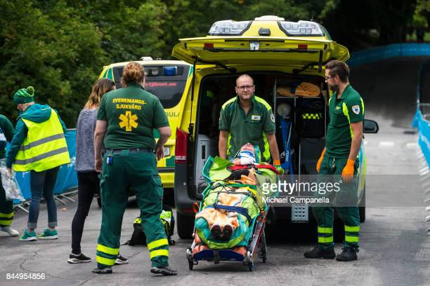 A cyclists is loaded into an ambulance after injuring himself while competing in the Men's Senior class of the Velothon GP race on September 9 2017...