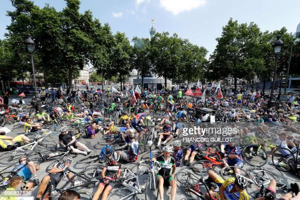 TOPSHOT Cyclists lay on the ground during a gathering called by the 'mon velo est une vie' committee to prevent bike accidents on June 17 2017 in...