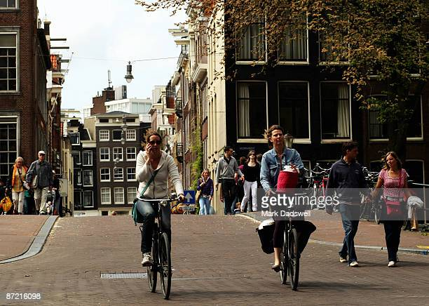 Cyclists make their way through the city streets on May 11 2009 in Amsterdam Netherlands The 750000 people who live in Amsterdam own over 600000...