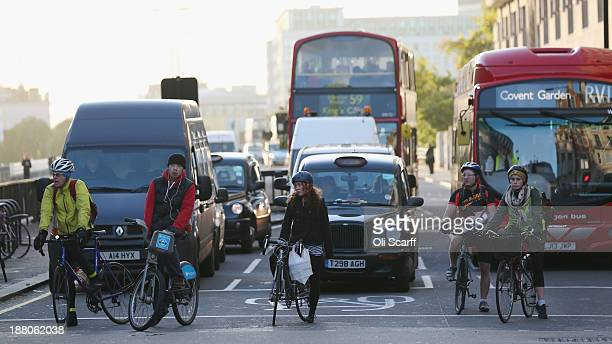 Cyclists negotiate rush hour traffic in central London near Waterloo Station on November 15 2013 in London England Over the course of the past 10...