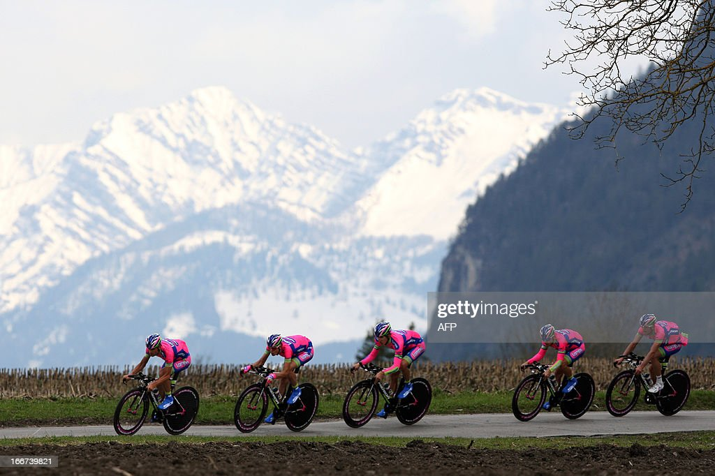 Cyclists of Lampre Merida Team with Italian's Michele Scarponi (L) ride during the Team Time Trial of 14.1 km of the cycling road race 'Giro del Trentino' in Lienz, on April 16, 2013. AFP PHOTO / PIERRE TEYSSOT