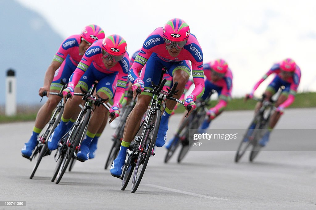 Cyclists of Lampre Merida Team with Italian's Michele Scarponi (2nd L) ride during the Team Time Trial of 14.1 km of the cycling road race 'Giro del Trentino' in Lienz, on April 16, 2013.