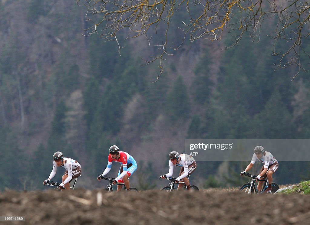 Cyclists of Team AG2R La Mondiale and Luxembourg's Ben Gastauer (2nd L) compete during the Team Time Trial of 14,1 km competition of the cycling road race 'Giro del Trentino' in Lienz, Austria, on April 16, 2013. AFP PHOTO / PIERRE TEYSSOT