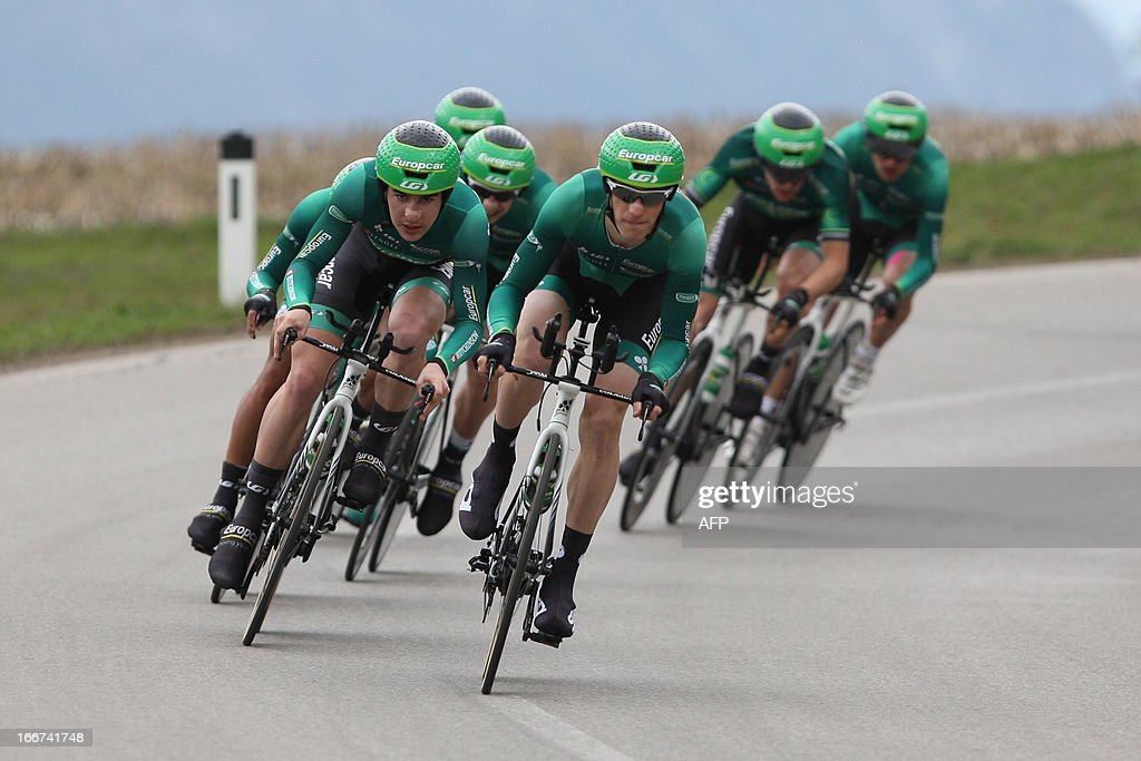 Cyclists of Team Europcar with French leader Pierre Rolland (C) compete during the Team Time Trial of 14,1 km competition of the cycling road race 'Giro del Trentino' in Lienz, Austria, on April 16, 2013. AFP PHOTO / PIERRE TEYSSOT
