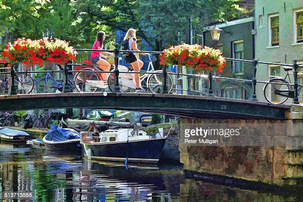 Cyclists on a bridge in Amsterdam