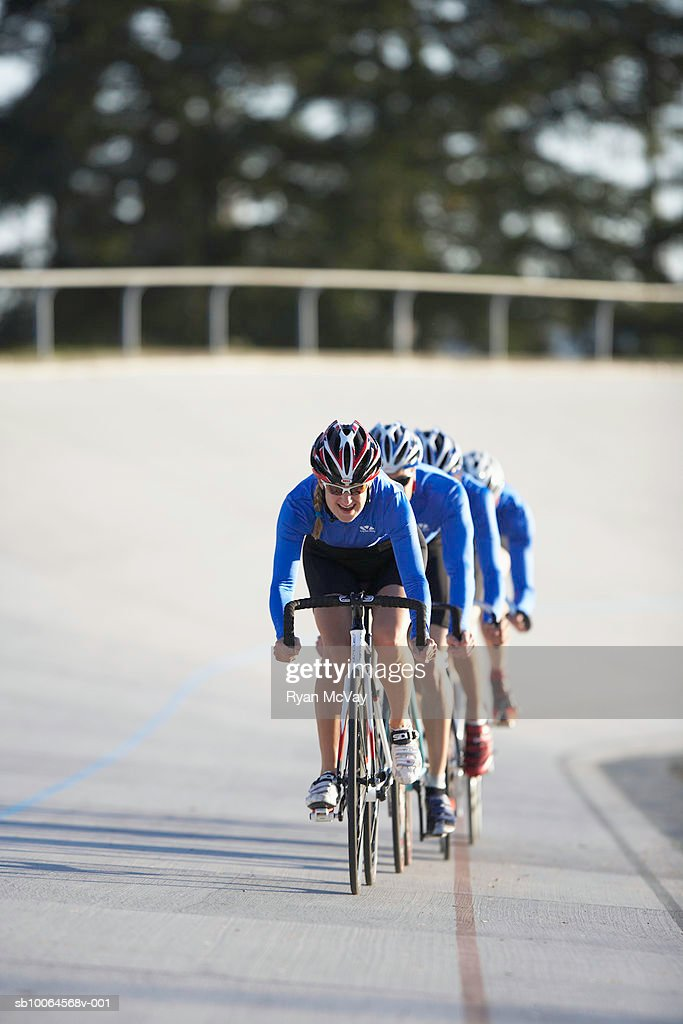 Cyclists on velodrome track