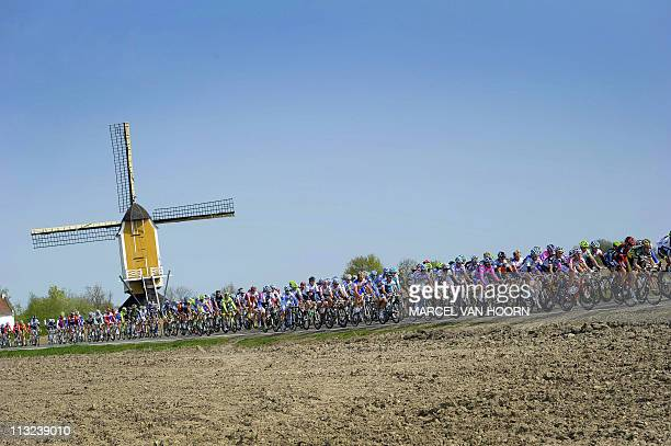 Cyclists pass a mill in Beek during the Amstel Gold Race on April 17 2011 AFP PHOTO / ANP / MARCEL VAN HOORN netherlands out belgium out