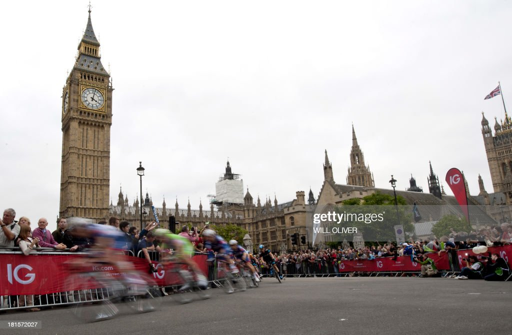 Cyclists pass Big Ben and Houses of Parliament during stage eight of the Tour of Britain in London on September 22, 2013. Bradley Wiggins won his home Tour of Britain as compatriot Mark Cavendish of Omega Pharma QuickStep cycling team took his third stage victory of this year's race.