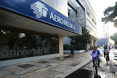 Cyclists pass Grupo Aeromexico SAB signage at the company's headquarters in Mexico City Mexico on Monday July 18 2016 Aeromexico is scheduled to...