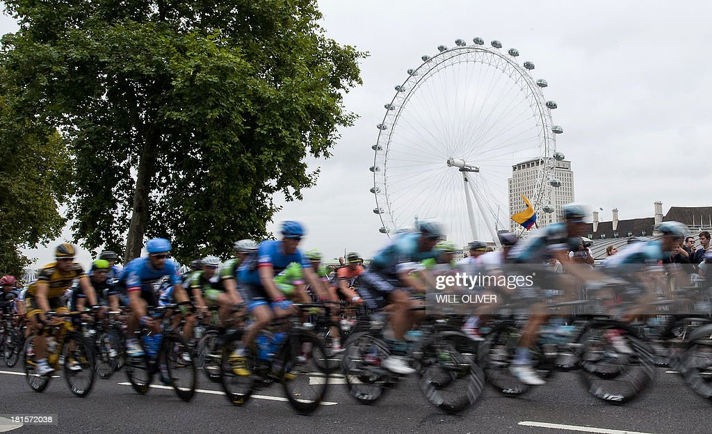 Cyclists pass the London Eye during stage eight of the Tour of Britain in London on September 22, 2013. Bradley Wiggins won his home Tour of Britain as compatriot Mark Cavendish of Omega Pharma QuickStep cycling team took his third stage victory of this year's race.