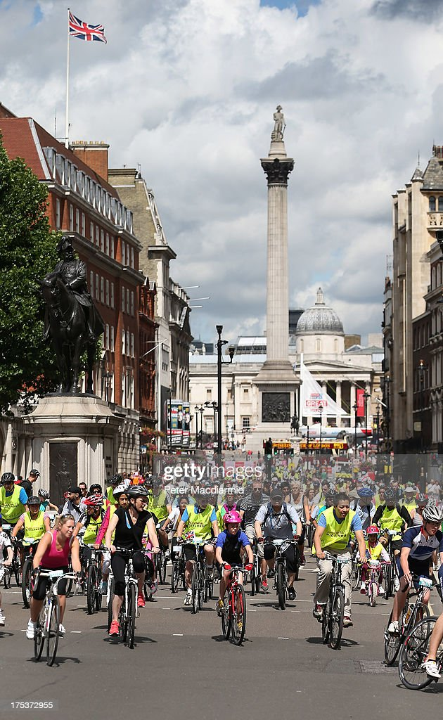Cyclists pass Trafalgar Square as they take part in the Ride London Freecycle event on August 3, 2013 in London, England. Up to 50, 000 cyclists are expected to ride the eight mile traffic free route through central London.