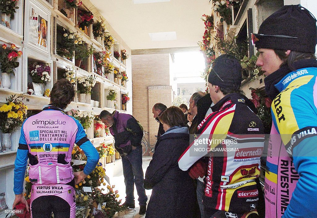 Cyclists pay their respect in front of the grave of famous Italian rider Marco Pantani, in occasion of the first anniversary of his death in Cesenatico, north-east Italy, 13 February 2005. Italy's most recent Tour de France champion Marco Pantani died alone in a hotel room at the Adriatic beach town of Rimini. He was only 34 years old.