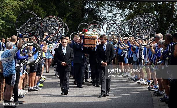 Cyclists perform a guard of honour with their bike wheels as the coffin of greatgrandfather Don Lock arrives at Worthing Crematorium on August 12...