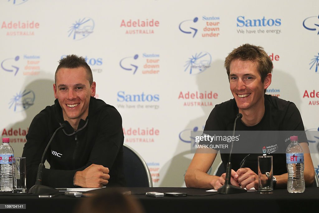Cyclists Phillip Gilbert (L) from Belgium and Andy Schleck (R) from Luxemburg talk at a press conference prior to the Tour Down Under in Adelaide, on January 19, 2013. The Tour Down Under runs from 20-27 January 2013. IMAGE STRICTLY RESTRICTED TO EDITORIAL USE - STRICTLY NO COMMERCIAL USE AFP PHOTO / Mark Gunter