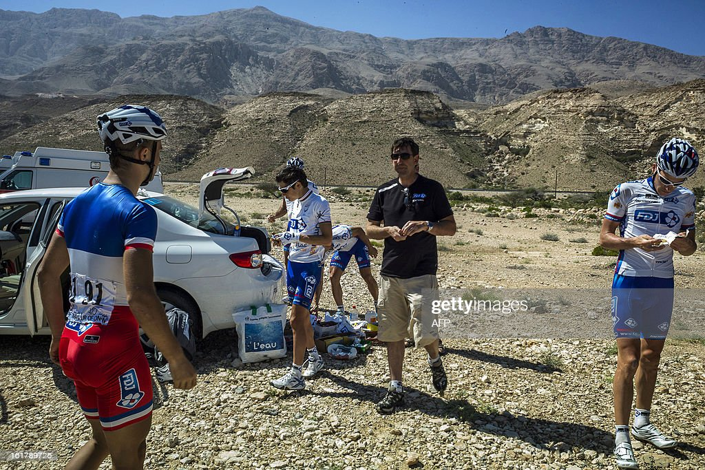 FDJ cyclists prepare before the start of the sixth and last stage of the Tour of Oman, on February 16, 2013. The final stage was a 144km ride from Hawit Nagam park in the south of the emirate to Muscat along the Matrah corniche.