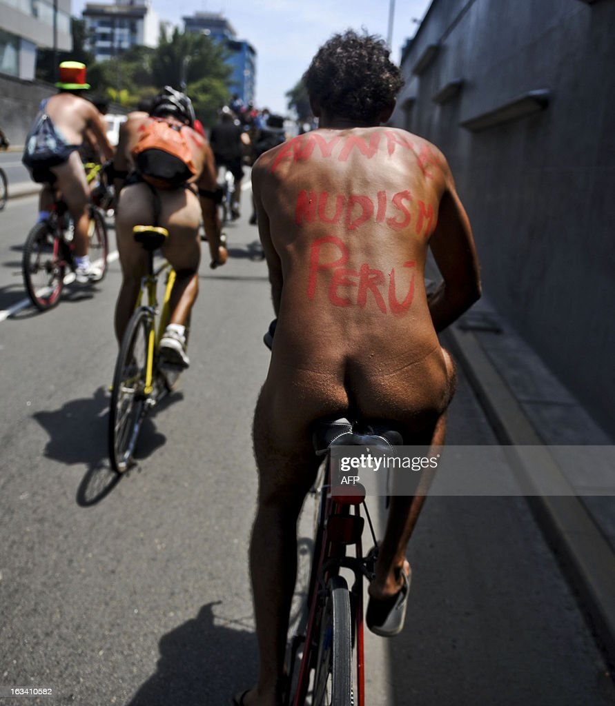 Cyclists protest in a naked bike ride to demand more bicycle paths in the city and more respect from motorists, in Lima on March 9, 2013. AFP PHOTO/Ernesto Benavides