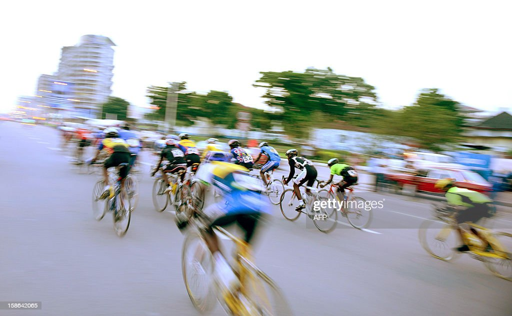 Cyclists race on December 22, 2012 in Kinshasa. The cycling federation of the Democratic Republic of Congo arranged a cycle race for peace attended by riders of the five regions in the Gombe district of Kinshasa. AFP PHOTO/Junior D.Kannah