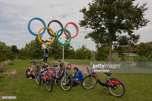 Cyclists rest at the Olympic rings a legacy of the London 2012 Olympics on 16th August 2017 in the Queen Elizabeth Olympic Park Stratford East London...