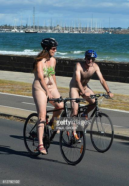 Cyclists ride along St Kilda beach to celebrate the World Naked Bike Ride in Melbourne on February 28 2016 The World Naked Bike Ride happens annually...