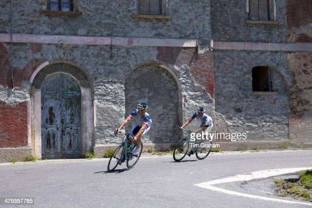 Cyclists ride Bianchi roadbikes on The Stelvio Pass Passo dello Stelvio Stilfser Joch in Northern Italy