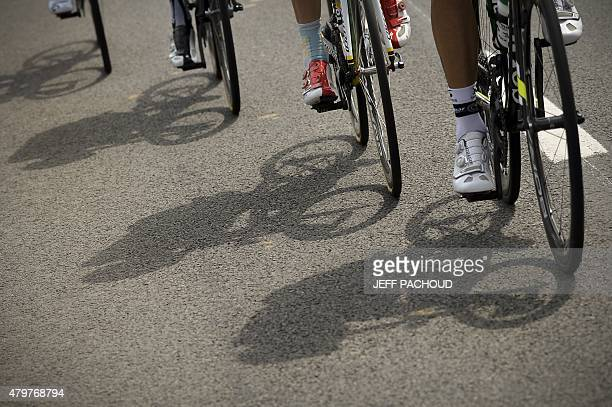 Cyclists ride during the 2235 km fourth stage of the 102nd edition of the Tour de France cycling race on July 7 between the Belgian city of Seraing...