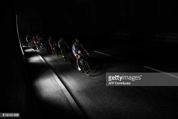 Cyclists ride in a tunnel during the 1795 km eighteenth stage of the 104th edition of the Tour de France cycling race on July 20 2017 between...