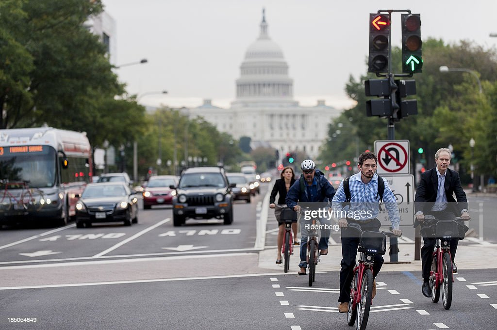 Cyclists ride next to cars on their way to work in Washington DC US on Thursday Oct 17 2013 The passage last night by wide margins an 8118 vote in...