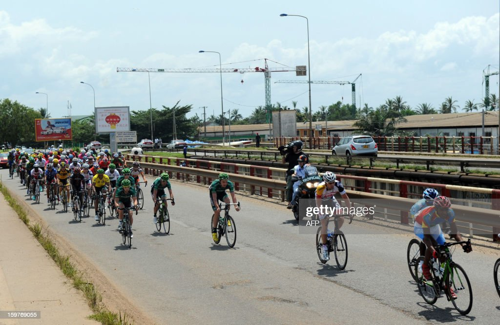 Cyclists ride on the bridge linking the suburb of Owendo to Libreville on January 20, 2013 during the seventh, 126 kms stage of the eighth edition of the Tropicale Amissa Bongo cycling race between Owendo and Libreville in Gabon. JORDAN