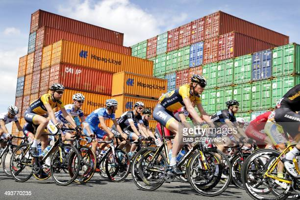 Cyclists ride past containers in Moerdijk during the second stage of the World Port Classic cycling race from Antwerp to Rotterdam on May 25 2014 AFP...