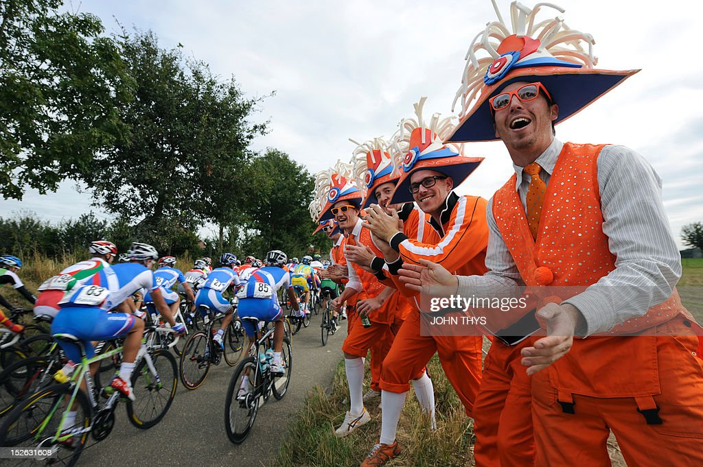 Cyclists ride past Dutch supporters during Men's Elite Race at the UCI Road World Championships on September 23, 2012 in Valkenburg.