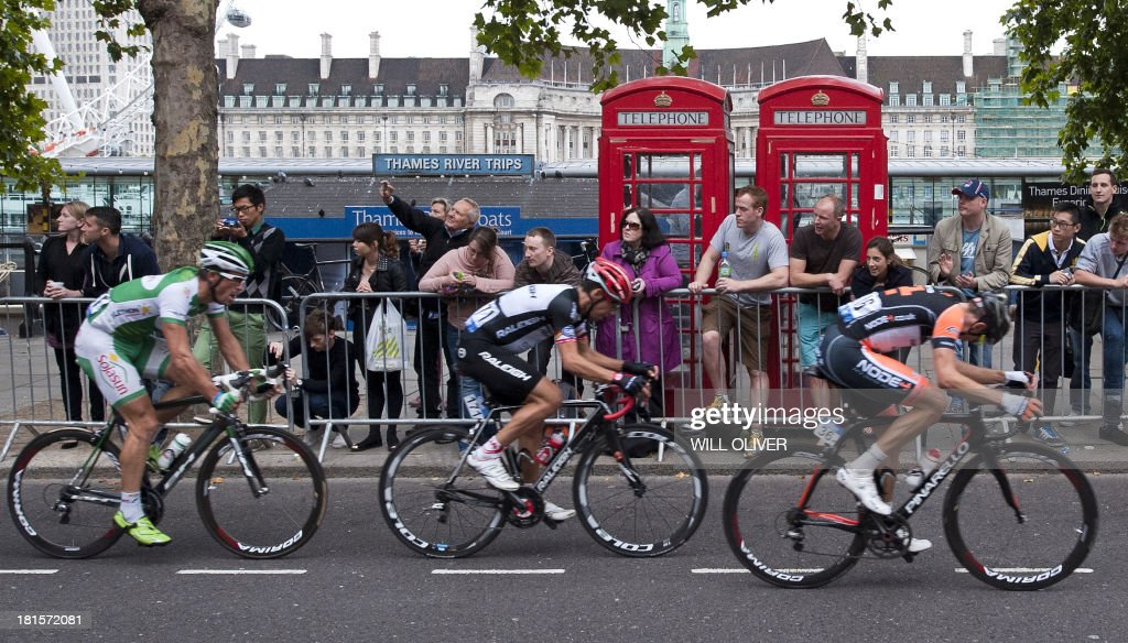 Cyclists ride past spectators as they compete in the final stage of Tour of Britain in London on September 22, 2013. Bradley Wiggins won his home Tour of Britain as compatriot Mark Cavendish of Omega Pharma QuickStep cycling team took his third stage victory of this year's race.