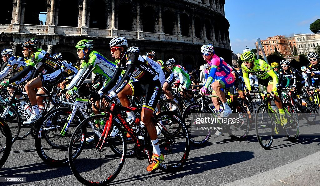 Cyclists ride past the Colosseum as they take part in the 'Roma Maxima' cycling race on March 3, 2013 in Rome.