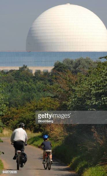 Cyclist's ride past the dome of British Energy's Sizewell B nuclear power plant in Sizewell Suffolk UK on Sunday July 27 2008 Electricite de France...