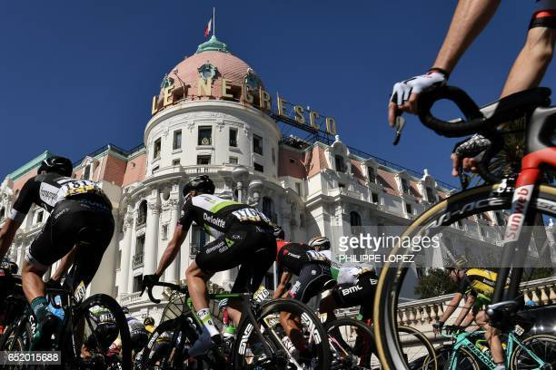 Cyclists ride past the Hotel Negresco in Nice as they take the start of the 177 km seventh stage of the 75th edition of the ParisNice cycling race...