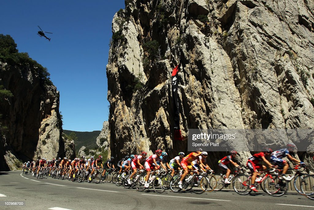 Cyclists ride the course of Stage 14 of the Tour de France, the first stage to enter the Pyrenees, on July 18, 2010 in Ax 3 Domaines, France. The 184.5km course from Revel features some of the toughest climbs so far in the race including the Port de Pailhères, which at 15.5 kilometers with an average gradient of 7.9% and higher may reveal who is strongest in the peloton. Luxembourg's Andy Schleck of team Saxo Bank continues to wear the yellow jersey, while Astana`s Alberto Contador of Spain is a close second. Christophe Riblon of France won the stage. The iconic bicycle race will include a total of 20 stages and will cover 3,642km before concluding in Paris on July 25.