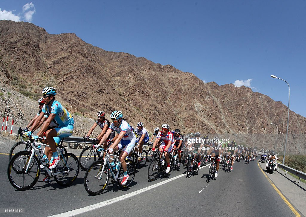 Cyclists ride their bikes during the fourth stage of the Tour of Oman, on February 14, 2013, in Oman. The fourth stage is a 152.5km ride through the mountains from Al Satiyah to the finish line at the peak of a stiff climb at Jabal Al Akhdar. AFP PHOTO / MOHAMMED MAHJOUB