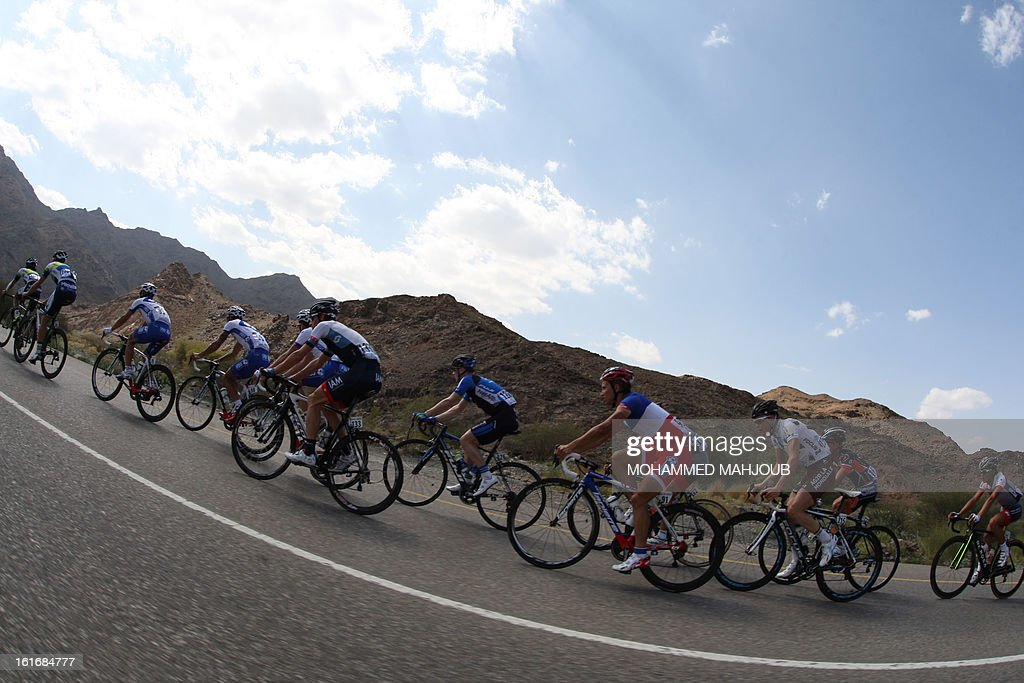 Cyclists ride their bikes during the fourth stage of the Tour of Oman, on February 14, 2013, in Oman. The fourth stage is a 152.5km ride through the mountains from Al Satiyah to the finish line at the peak of a stiff climb at Jabal Al Akhdar.
